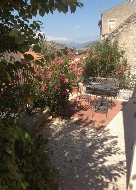 Casa Rosa, view from garden down to terrace and Grans Sasso mountain in the distance